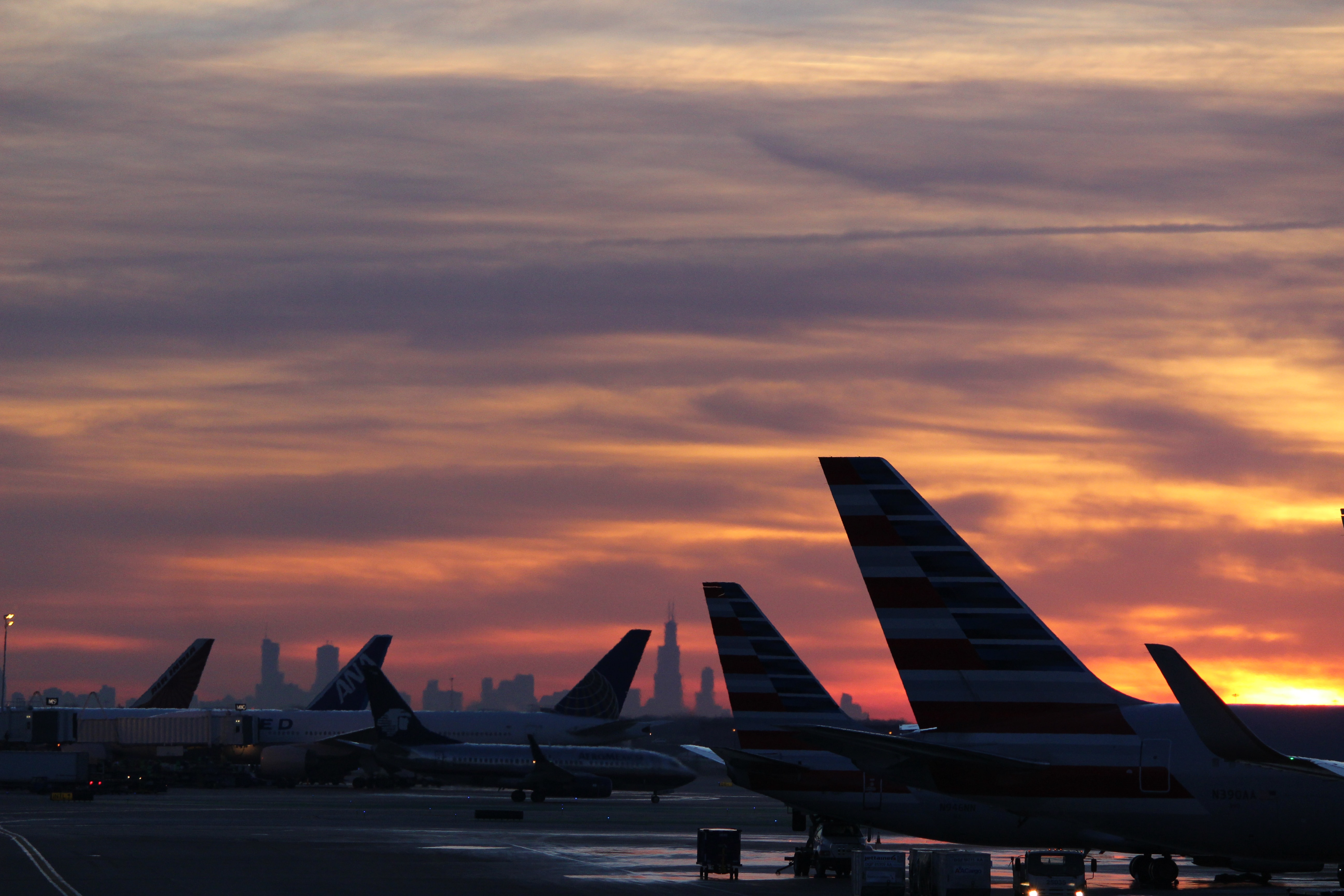 airplane on airport during sunset