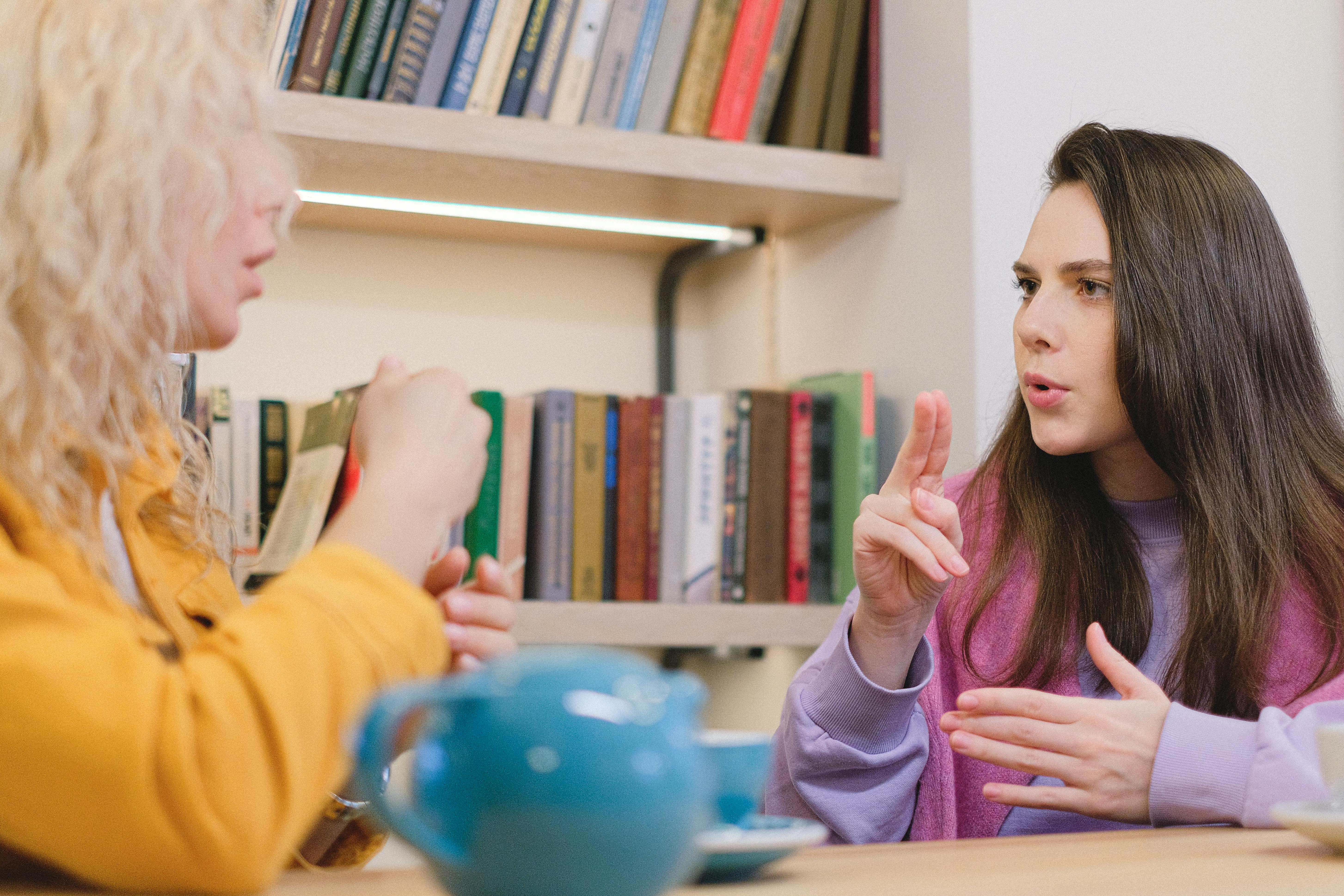 Deaf mute friends in university library